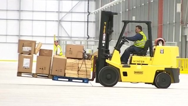 Forklift truck in warehouse
