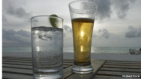 Beer and lemonade on a beachside table