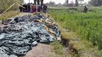 Bodies lie covered at scene of hot air balloon crash near Luxor (26/02/13)