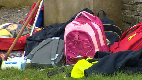 School bags at the side of the road