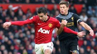 Robin van Persie challenged by Steven Gerrard
