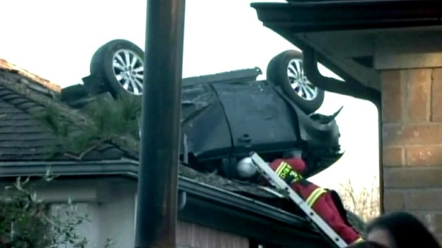 A car stuck in a roof