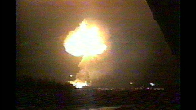 The fireball caused by three bombs which went off at the gasworks