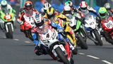 John McGuinness leads the Superbike riders at the 2012 North West 200