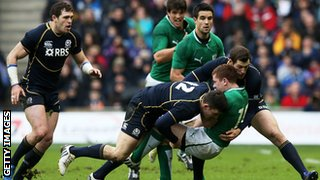 Ireland's Paddy Jackson is halted by Matthew Scott and Tim Visser