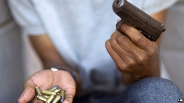 A man with a gun and bullets in South Africa - November 2012