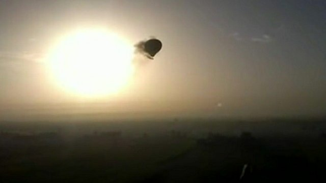 Balloon trailing smoke