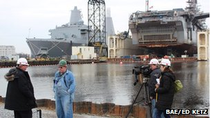 Mark Mardell doing an interview with Tom Ehret in a military shipyard in Newport News, Virginia 26 February 2013