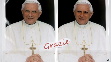 Posters of Pope Benedict XVI at a gift shop near the St. Peter's Basilica, at the Vatican on Tuesday,