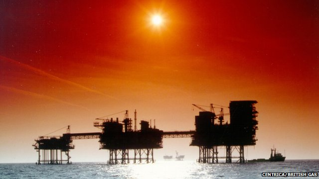 Oil rigs in silhouette