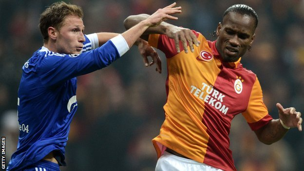 Benedikt Howedes and Didier Drogba