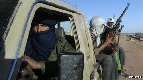 Soldiers from the Tuareg rebel group MNLA ride in a pickup truck in the north-eastern town of Kidal on 4 February 2013