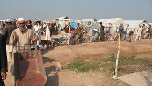 Internally displaced people in Jalozai camp queuing for rations