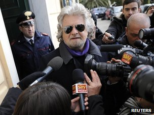 Beppe Grillo speaks to reporters in Genoa (25 February 2013)