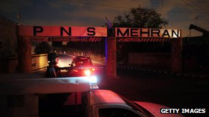 A policeman guards Mehran naval base in Karachi