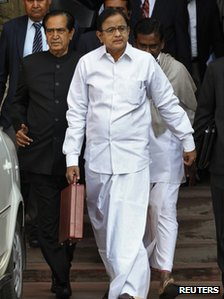 "India""s Finance Minister Palaniappan Chidambaram walks as he leaves his office to present the 2013/14 federal budget in New Delhi February 28, 2013."