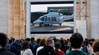 People in St Peter's Square in the Vatican watch a giant screen of the helicopter waiting to carry Pope Benedict XVI to the papal summer residence at Castel Gandolfo on Thursday