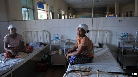 "This picture taken on February 27, 2013 shows injured villagers sitting on beds at a hospital in Maubin, in Myanmar""s Delta region, following clashes with police."