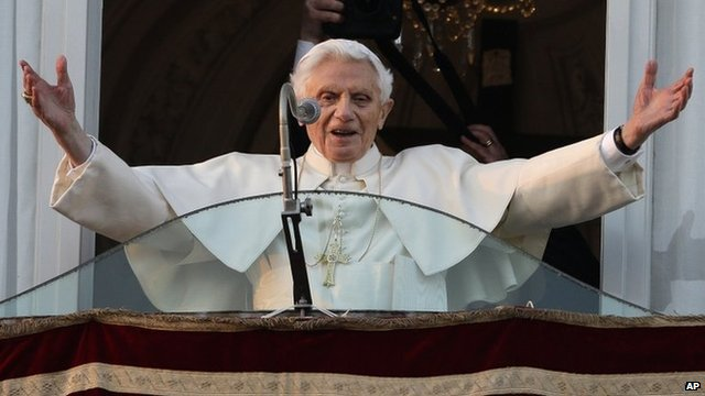 Pope Benedict XVI greets the crowd from the window of the Pope's summer residence of Castel Gandolfo