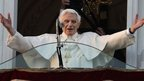 Pope Benedict XVI greets the crowd from the window of the Pope&#039;s summer residence of Castel Gandolfo