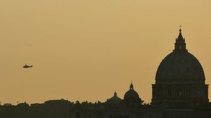 The helicopter with Pope Benedict XVI aboard flies over St Peter'' basilica at the Vatican on 28 February 2013 in Rome
