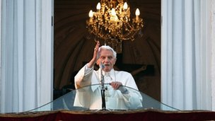 Pope Benedict XVI blesses the faithful from the balcony of his summer residence at Castel Gandolfo, 28 February 2013