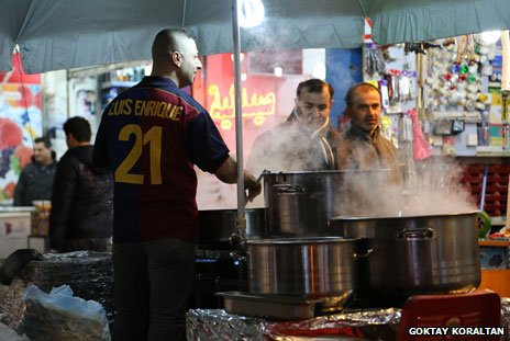 Street vendor in Erbil in Barca shirt