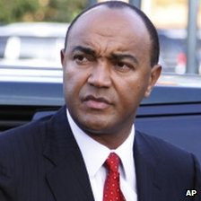 Presidential candidate Peter Kenneth, center, arrives to take part in a televised debate between presidential contenders, in Nairobi, Kenya Monday, Feb. 11, 2013.