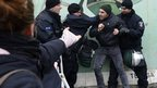 Protesters scuffle with police at the Berlin Wall