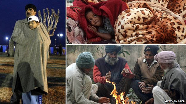 Indians in Calcutta trying to keep warm