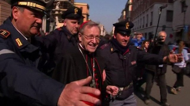 A cardinal arrives in the Vatican