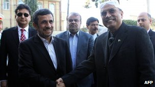 "Iran""s President Mahmoud Ahmadinejad (L) shakes hands with Pakistan""s President Asif Ali Zardari upon his arrival for a meeting on February 27"