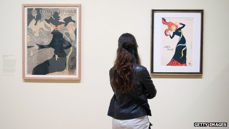 Visitor looks at works by  Henri de Toulouse-Lautrec at the Courtauld gallery in London