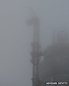 Crane surrounded by fog