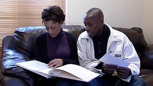 Lloyd and Jayne Gordon look at a book of messages left following Kalisha's funeral.
