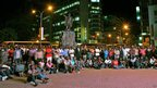 Crowds gather to watch the second and last televised debate for the 2013 Kenya elections on a large screen in central Nairobi on 25 February 2013