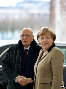 German Chancellor Angela Merkel greets Italian President Giorgio Napolitano in Berlin, 28 March