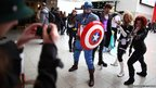 Enthusiasts pose for a photo at the Super Comic Convention