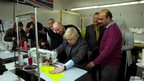 London mayor Boris Johnson at a sewing machine