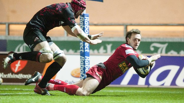 Andy Fenby scores a try for the Scarlets against Edinburgh