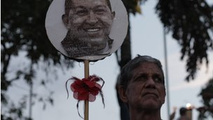 Efrain Perez holding a picture of Hugo Chavez