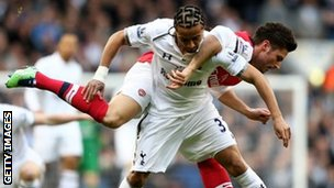 Benoit Assou-Ekotto of Spurs and Olivier Giroud of Arsenal