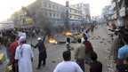 Islamist protesters block street and light fires in Bogra