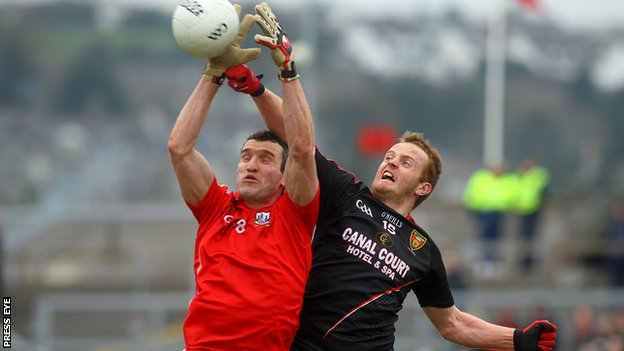 Cork's Graham Canty battles with Down's Benny Coulter at Newry