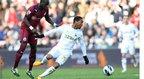 Swansea's Jonathan De Guzman retains possession
