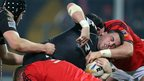 Munster's Paddy Butler and Stephen Archer tackle Ospreys hooker Scott Baldwin as the teams draw 13-13 in the Pro12