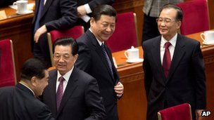 Chinese President Hu Jintao (2nd left), Communist Party chief Xi Jinping (C) and Chinese Premier Wen Jiabao after the opening session of the CPPCC in Beijing, 3 March 2013