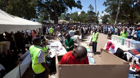 A man casts his vote as people queue ready to vote in the Mshomoroni area of the coastal city of Mombasa on 4 March 2013 during the nationwide election