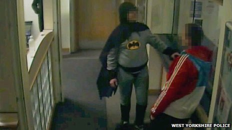 'Batman' brings in suspect to police