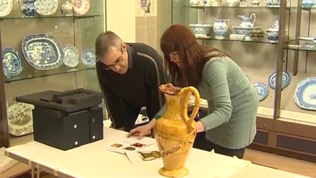 Staff at National Museum Wales pack up the art